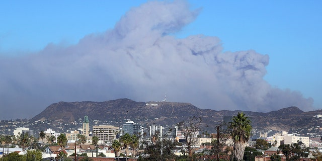 Smoke from the Creek wildfire in the San Gabriel Mountains, a range behind the Hollywood Hills, looms over Los Angeles.