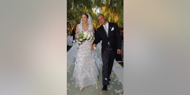Actress and singer Jennifer Lopez, 31, holds hands with choreographer Cris Judd, 32, during their wedding ceremony, in Calabasas, Calif.