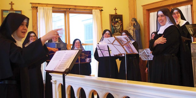 """Nov. 18, 2013. Mother Cecilia, left, conducts the Sisters during the recording sessions for """"Lent at Ephesus"""" in the chapel at the Priory of The Benedictines of Mary called """"Ephesus"""" near Gower, Mo. The Benedictines of Mary were named Billboard's Top Traditional Classical Album Artist of 2013, for the second year in a row."""