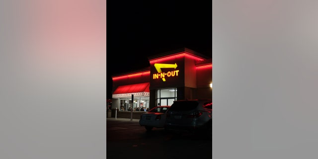 Rancho Cordova, California, USA - December 6, 2016:View at the In-n-out Burger restaurant  from the parking lot, at night. Patrons sitting and dinning inside. In-N-Out Burger, Inc. is a regional chain of fast food restaurants with locations primarily in the American Southwest and Pacific coast.
