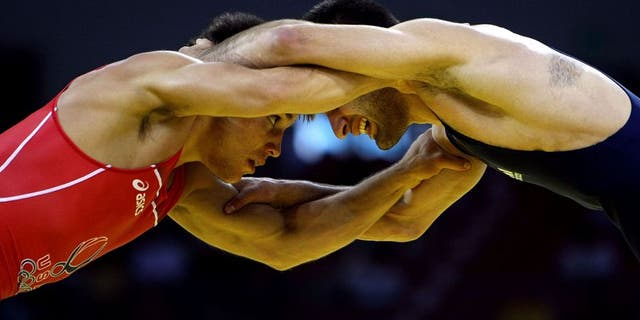 BEIJING - AUGUST 19: Henry Cejudo (red) of the United States competes against Besarion Gochashvili of Georgia during the 55kg freestyle wrestling event at the China Agriculture University Gymnasium on Day 11 of the Beijing 2008 Olympic Games on August 19, 2008 in Beijing, China. (Photo by Jed Jacobsohn/Getty Images)