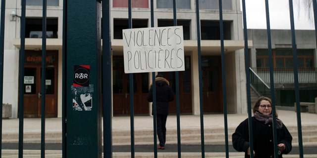 "A placard reading ""police violence"" is displayed on the entrance of the Henri Bergson college after a protest against alleged police abuses, in Paris, Thursday, Feb. 23, 2017. (AP Photo/Thibault Camus)"