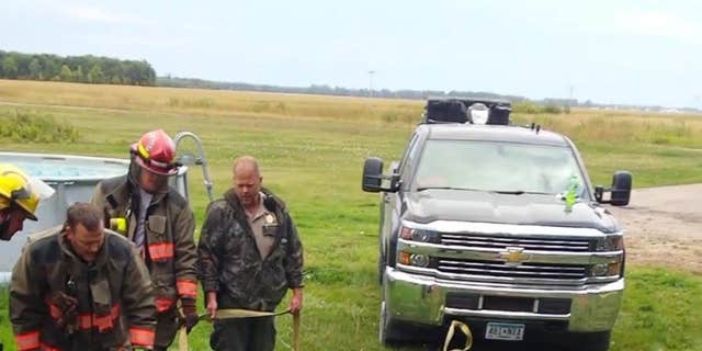 "The Roseau Fire Department was called in to help the bear and, with ""some special equipment,"" the group was able to free the furry animal."