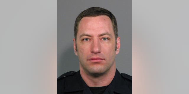 This undated photo provided by the San Jose Police Department shows San Jose Police Officer Michael Johnson. Johnson was fatally shot by Scott Dunham on Tuesday, March 24, 2015, launching an hourslong manhunt. The search ended when Dunham was found dead early Wednesday on his apartment balcony, San Jose police spokesman Albert Morales said. (AP Photo/San Jose Police Department)