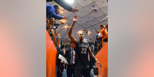 Georgetown's Otto Porter high-fives fans as he exits the court after his team defeated Syracuse 57-46 in an NCAA college basketball game in Syracuse, N.Y., Saturday, Feb. 23, 2013. (AP Photo/Kevin Rivoli)