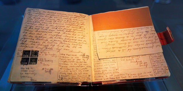 The well-known first diary of Anne Frank sits on display in the Anne Frank House in Amsterdam April 28, 2010. (REUTERS/Cris Toala Olivares)