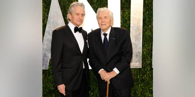 Michael Douglas, left, and Kirk Douglas arrive at the Vanity Fair Oscar party in West Hollywood, Calif., in February 2012.