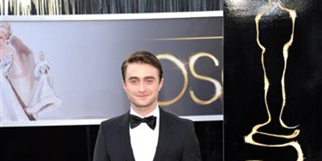 """Daniel Radcliffe knows he may never escape """"Harry Potter,"""" but says he embraces it."""