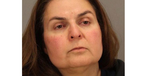 In this April 29, 2013 photo released by the San Jose Police Department is Ramineh Behbehanian, 50. Behbehanian is facing attempted murder charges after authorities say she tried to sneak orange juice bottles spiked with rubbing alcohol inside a Starbucks.