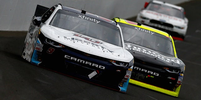 The distinctive aerodynamics kit to be used by the NASCAR Cup cars at Charlotte can be seen on these Xfinity series cars competing at Indianapolis Motor Speedway last year.