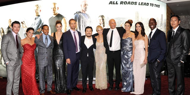 "Actors Luke Evans, Michelle Rodriquez, Chris Ludacris Bridges, Gal Gadot, Paul Walker, director Justin Lin and actors Elsa Pataky, Vin Diesel, Gina Carano, Jordana Brewster, Tyrese Gibson and Ssung Kang attend the ""Fast and Furious 6"" world premiere on May 7, 2013 in London."