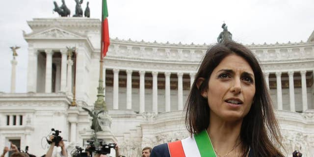 In this Thursday, June 23, 2016 filer, Rome's Mayor Virginia Raggi leaves the Rome's Vittoriano Unknown soldier monument after laying a wreath. Recently, many Romans have been concerned due the conditions in the city.