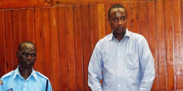 Risley Lever Kavu appears in court on September 30, 2013 in Mombasa for the alleged murder of his British girlfriend