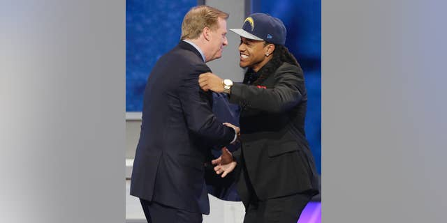 Texas Christian cornerback Jason Verrett is greeted by NFL commissioner Roger Goodell after being selected by the San Diego Chargers as the 25th pick of the first round of the 2014 NFL Draft, Thursday, May 8, 2014, in New York.(AP Photo/Frank Franklin II)