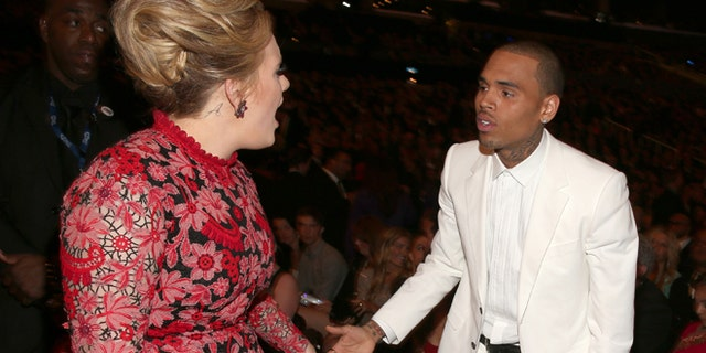 Singer Adele and singer Chris Brown attend the 55th Annual GRAMMY Awards at Staples Center on February 10, 2013 in Los Angeles, California.  (Photo by Christopher Polk/Getty Images for NARAS)