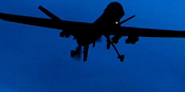 A U.S. Predator drone flies above Kandahar Air Field, southern Afghanistan Sunday, Jan. 31, 2010 - file photo.