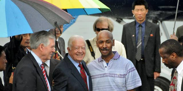 Aijalon Gomes with former President Jimmy Carter following his release from North Korea in 2010.