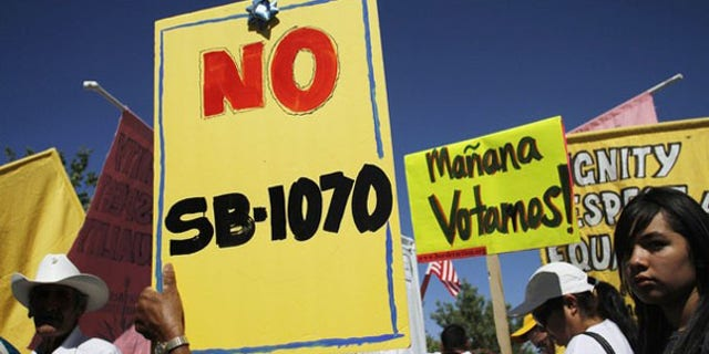Demonstrators protest against Arizona's immigration law in Phoenix last year.