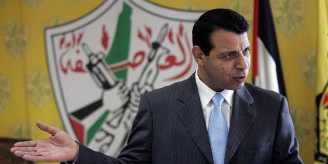 Palestinian politician Mohammed Dahlan speaks in his office in Ramallah, West Bank, Jan. 3, 2011.