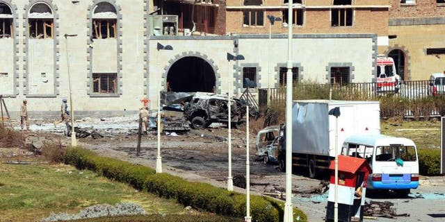 December 5, 2013: In this photo provided by Yemen's Defense Ministry, security forces are on the scene after an explosion at the Defense Ministry complex in Sanaa, Yemen. A suicide car bomber struck Yemen's Defense Ministry Thursday, killing more than a dozen soldiers and paving the way for a carload of gunmen wearing army uniforms to storm the heavily guarded compound in the capital of Sanaa, military and hospital officials said. (AP Photo/Yemen Defense Ministry) (The Associated Press)