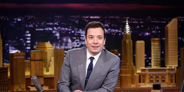 """In this photo provided by NBC, Jimmy Fallon appears during his """"The Tonight Show"""" debut on Monday, Feb. 17, 2014, in New York. Fallon departed from the network's Late Night on Feb. 7, 2014, after five years as host, and is now the host of The Tonight Show, replacing Jay Leno after 22 years. (AP Photo/NBC, Lloyd Bishop)"""