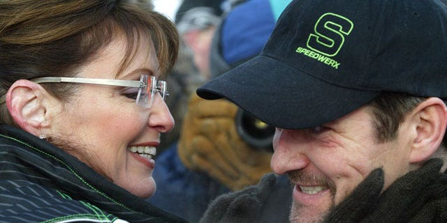 Feb. 14, 2009: Former Alaska Gov. Sarah Palin greets her husband Todd at the finish line of the 2009 Tesoro Iron Dog. (AP)