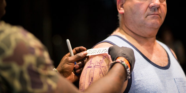 "Healing Ink recipient, Tom Canavan, gets his ""survivor"" tattoo to help heal after going through 9/11."
