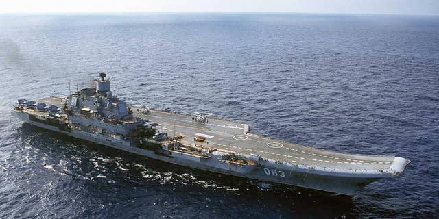 FILE - In this 2004 file photo the Admiral Kuznetsov carrier seen in the Barents Sea, Russia. The Russian military says one of its the MiG-29 fighter jets based at a Russian aircraft carrier currently near Syria's shores has crashed on a training mission, but its pilot has survived. (AP Photo, File)