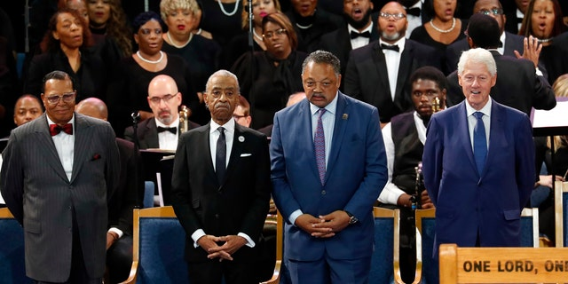 Louis Farrakhan, from left, Rev. Al Sharpton, Rev. Jesse Jackson and former President Bill Clinton attend the funeral service for Aretha Franklin at Greater Grace Temple, Friday, Aug. 31, 2018, in Detroit. (AP Photo/Paul Sancya)