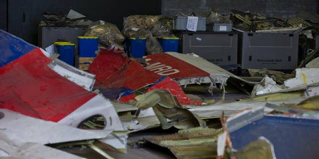 Parts of the wreckage of the Malaysia Airlines Flight 17 are displayed in a hangar at Gilze-Rijen airbase, Netherlands.
