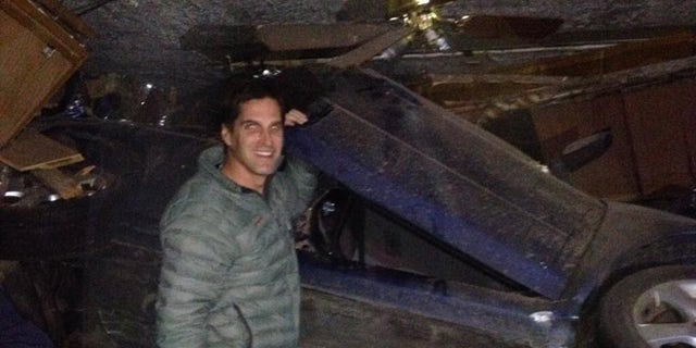 Nov. 28, 2013: Josh Romney, son of former presidential candidate Mitt Romney, tweeted this photo of himself at an accident scene in which he helped a family of four after they crashed into a house in Holladay, Utah. No one was hurt in the accident.