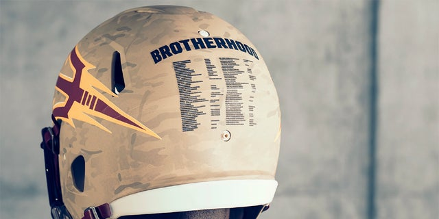 On the back of the helmet lists all player and coaches on the ASU squad who were or are currently serving in the military.