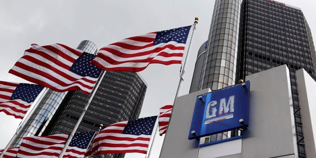 FILE: American flags fly outside General Motors world headquarters in Detroit.