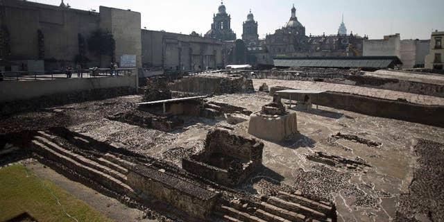 File photo - Tourists visit the Templo Mayor archaeological site in Mexico City, Tuesday Dec. 1, 2015.