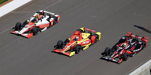 Ryan Hunter-Reay responds to a question during a news conference before the Indianapolis 500 auto race at Indianapolis Motor Speedway in Indianapolis, Thursday, May 21, 2015.  (AP Photo/Darron Cummings)