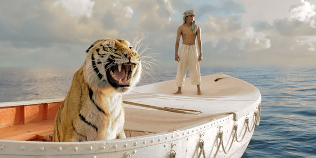 """This publicity film image released by 20th Century Fox shows Suraj Sharma in a scene from """"Life of Pi,"""" directed by Ang Lee. Best-picture prospects for Oscar Nominations on Thursday, Jan. 10, 2013, include, """"Lincoln,"""" directed by Steven Spielberg; """"Zero Dark Thirty,"""" directed by Kathryn Bigelow; """"Les Miserables,"""" directed by Tom Hooper; """"Argo,"""" directed by Ben Affleck; """"Django Unchained,"""" directed by Quentin Tarantino; and """"Life of Pi,"""" directed by Ang Lee. (AP Photo/20th Century Fox, Jake Netter, File)"""
