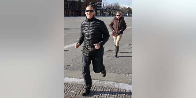 """FILE - In this Dec. 2014, file photo, Dell """"Super Dell"""" Schanze arrives for a court appearance at the federal courthouse in Salt Lake City. Schanze, a former TV pitchman in Utah accused of kicking a barn owl in flight while riding a motorized paraglider, is expected to enter a plea in the case. (AP Photo/Rick Bowmer, File)"""