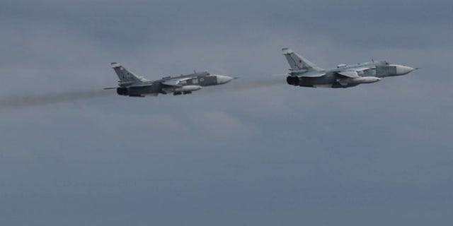 A pair of Russian Su-24 jets pass within close proximity of the guided-missile destroyer USS Porter in an aggressive action taken by Russia on Friday.