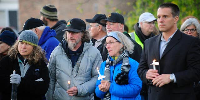 Mourners hold candles Monday, Oct. 10, 2016, during a candlelight vigil attended by abut 1,000 at Harwood Union High School in Duxbury, Vt., for the teenaged victims killed in Saturday night's crash on Interstate 89 in Williston. Four of the five teens killed by the wrong-way driver were students at Harwood. The fifth student killed was from Fayston and attended a private school in New Hampshire. (Stefan Hard/Times Argus via AP)