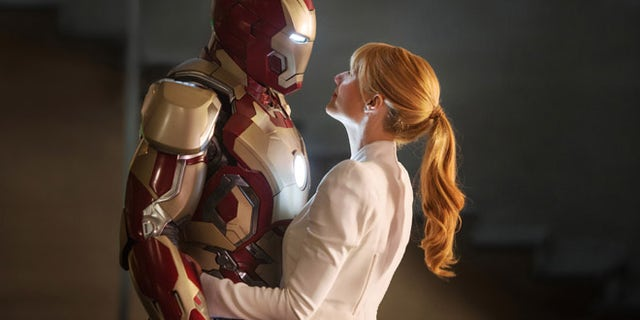 """This film publicity image released by Disney-Marvel Studios shows Robert Downey Jr., left, as Tony Stark/Iron Man and Gwyneth Paltrow as Pepper Potts in a scene from """"Iron Man 3."""""""