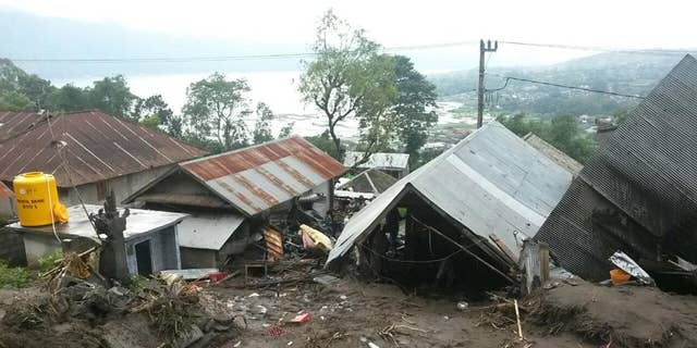 Houses are seen buried under the mud following a landslide in Songan village on Bali island, Indonesia, Friday, Feb. 10, 2017. A number of people including young children were killed in the landslides on the tourist island that wiped out several homes, Indonesia's disaster mitigation agency said. (AP Photo)