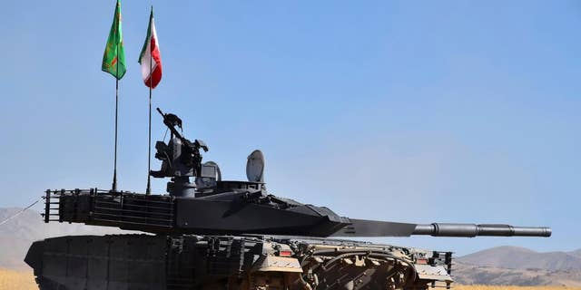 This design expelled by a central website of a Iranian Defense Ministry on Sunday, Mar 12, 2017, shows a domestically done tank called Karrar in an undisclosed plcae in Iran. Iran's semi-official Fars news organisation is stating that a nation has denounced a domestically done tank and has launched a mass-production line. (Iranian Defense Ministry around AP)
