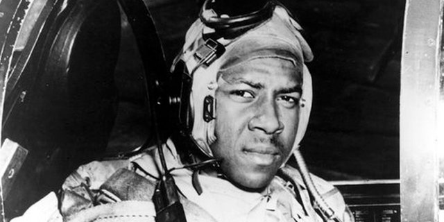 Jesse Brown in the cockpit of an F4U-4 Corsair fighter at an unidentified location in 1950.