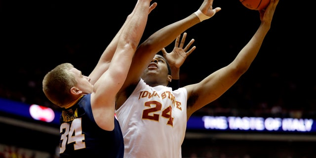 Iowa State center Percy Gibson (24) shoots over West Virginia forward Kevin Noreen during the first half of an NCAA college basketball game, Wednesday, Jan. 16, 2013, in Ames, Iowa. (AP Photo/Charlie Neibergall)