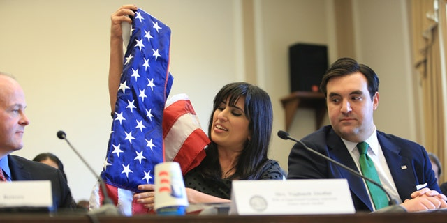 Naghmeh Abedini, wife of imprisoned American pastor Saeed Abedini, displays a U.S. flag her husband  received when he became a U.S. citizen in this Marc, 2013 file photo.