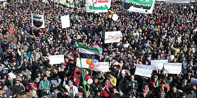 In this citizen journalism image provided by the Local Coordination Committees in Syria and released Friday, Feb. 3, 2012, anti-Syrian regime protesters march in Bensh, Idlib Province, northern Syria.