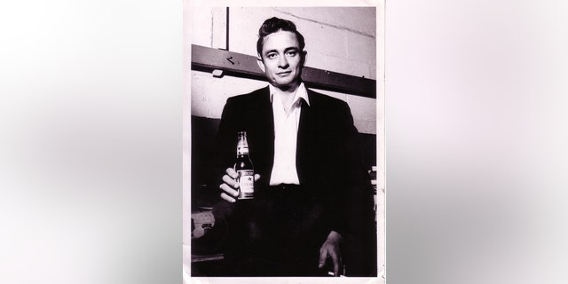 Johnny Cash with a Molson Canadian backstage in London, Ontario, 1958.