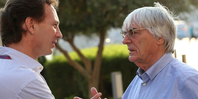 """FILE - In this Thursday, Nov. 1, 2012 file photo, Red Bull team principal Christian Horner, left, talks with Bernie Ecclestone, president and CEO of Formula One Management, at the Yas Marina racetrack in Abu Dhabi, United Arab Emirates. With Ecclestone's Formula One future in doubt amid bribery allegations, one of the most influential team bosses on Wednesday, Jan. 15, 2014 said the series' prosperity relies on him remaining in charge. Christian Horner, team principal of reigning constructors' champion Red Bull, believes Ecclestone is """"the only guy"""" who can ensure F1 maintains its global reach as the premier motorsport series. (AP Photo/Luca Bruno, File)"""