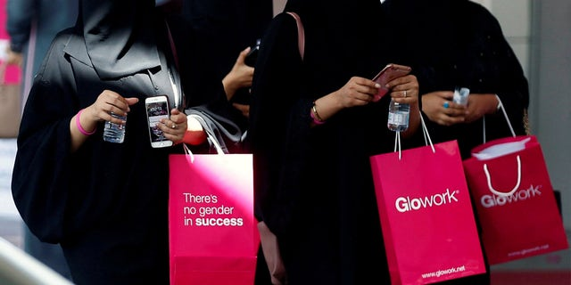 Saudi women take part in Glowork exhibition in Riyadh.