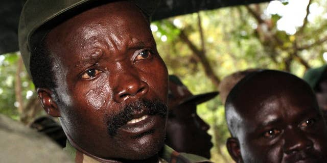 Joseph Kony, the leader of the Lord's Resistance Army, answers journalists' questions following a meeting with UN humanitarian chief Jan Egeland at Ri-Kwangba in Southern Sudan on Nov. 12, 2006. Kony has been Africa's most notorious warlord for three decades. Now that the United States and others are ending the international manhunt for him and his Lord's Resistance Army, it appears Kony may never be brought to justice. (AP Photo/Stuart Price, File)
